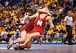 March 21 2009      Craig Brester (red, at front) from Nebraska battles Jake Varner (maroon) from Iowa State in the 197 pound weight class in the championship round of the NCAA Division I  Wrestling Championships which were held March 19 through March 21, 2009 at the Scottrade Center in downtown St. Louis, Missouri.  ..         *******EDITORIAL USE ONLY*******