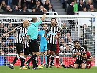 Newcastle United's Mikel Merino is shown a yellow card by Referee Craig Pawson after he fouled Liverpool's Mohamed Salah<br /> <br /> Photographer Rich Linley/CameraSport<br /> <br /> The Premier League -  Newcastle United v Liverpool - Sunday 1st October 2017 - St James' Park - Newcastle<br /> <br /> World Copyright &copy; 2017 CameraSport. All rights reserved. 43 Linden Ave. Countesthorpe. Leicester. England. LE8 5PG - Tel: +44 (0) 116 277 4147 - admin@camerasport.com - www.camerasport.com
