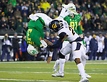 Oct 07, 2015; Eugene, OR, USA; Oregon Ducks quarterback Vernon Adams Jr. (3) jumps over California Golden Bears safety Stefan McClure (21) for a touchdown at Autzen Stadium. <br /> Photo by Jaime Valdez