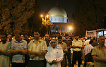 Palestinian Muslims pray during the Laylat Al-Qadr on the 27th day of the holy fasting month of Ramadan in Jerusalem's Old City, early 09 October 2007 in the Dome of the Rock Mosque, in the Al Aqsa Mosque compound, the third holiest site for Muslims. Laylat Al Qadr, the most important prayer of the fasting month, is the night Muslims commemorate the revelation of the first verses of the Quran to their prophet Mohammed through the angel Gabriel. Muslims spend the night in worship and devotion, praying for the souls of the dead