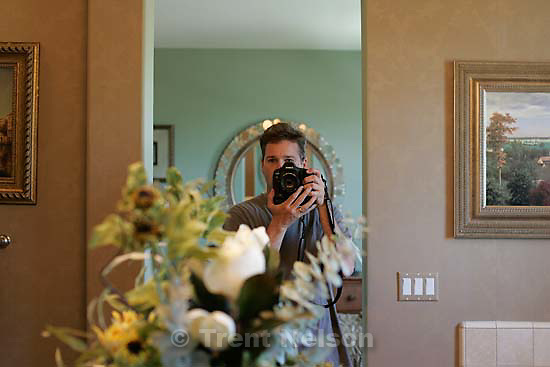 Trent Nelson in mirror with camera. Windemere model home tour; 5/1/04<br />