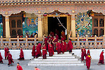 Buddhist monks walking out of the Zong ( temple)