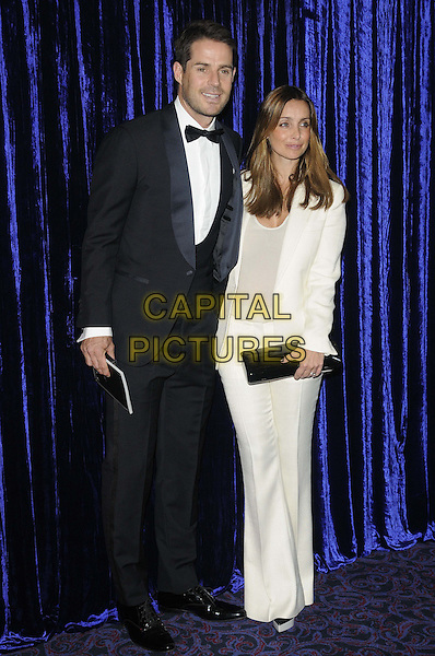 Jamie Redknapp & Louise Redknapp.attended the Retail Trust London Ball, Grosvenor House Hotel, Park Lane, London, England..January 28th, 2013.full length white blazer top trousers suit black clutch bag tuxedo married husband wife .CAP/CAN.©Can Nguyen/Capital Pictures.