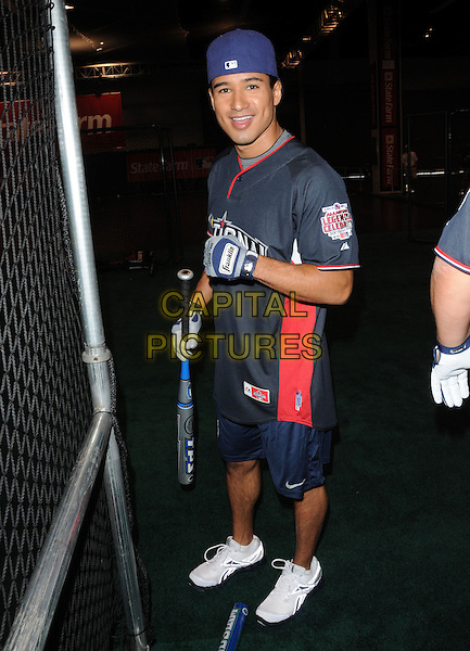MARIO LOPEZ.At the MLB All Star Fanfest Batting Practice held at The Anaheim Convention Center , the precursor to The All Star Legends Celebrity Softball game in Anaheim, California, USA..July 11th, 2010.full length red top baseball bat shorts hat .CAP/RKE/DVS.©DVS/RockinExposures/Capital Pictures.
