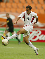 Landon Donovan stretches for the ball. The USA tied South Korea, 1-1, during the FIFA World Cup 2002 in Daegu, Korea.