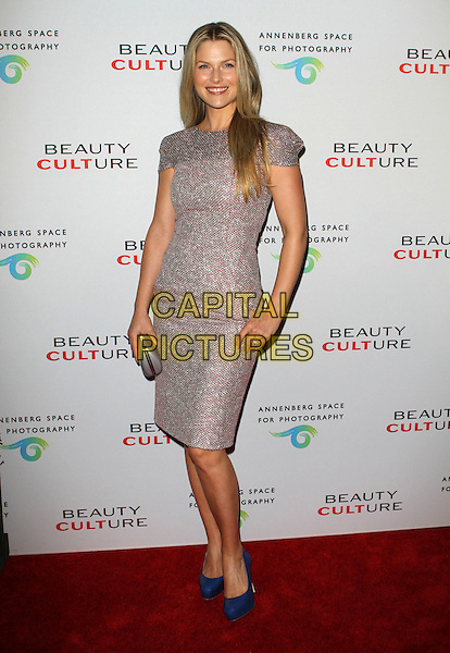 ALI LARTER .at The opening of Beauty Culture - a photographic exploration of how feminine beauty is defined, challenged and revered in modern society held at Annenberg Space for Photography in Century City, California, USA,.May 19th 11..full length  red silver woven dress blue shoes clutch bag silver .CAP/ADM/KB.©Kevan Brooks/AdMedia/Capital Pictures.