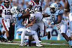 04 October 2014: Virginia Tech's Sam Rogers (45) is tackled by UNC's Brian Walker (28) and Norkeithus Otis (8). The University of North Carolina Tar Heels hosted the Virginia Tech Hokies at Kenan Memorial Stadium in Chapel Hill, North Carolina in a 2014 NCAA Division I College Football game. Virginia Tech won the game 34-17.