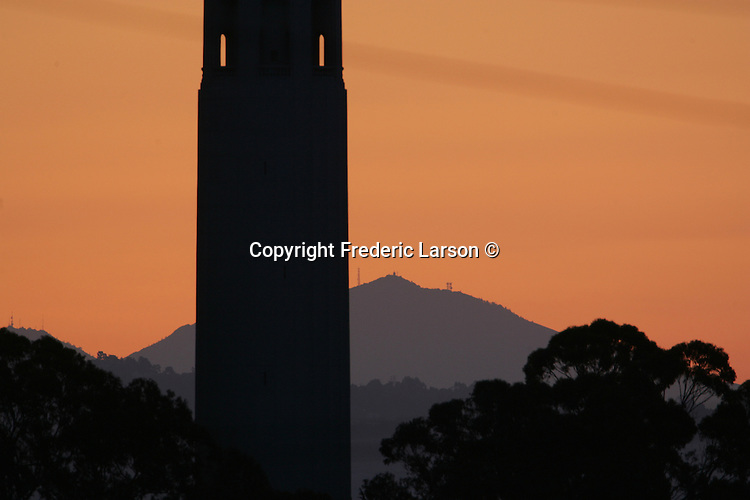Coit Tower and Mt. Diablo were the prominent images during sunrise viewed From Hyde St., hill in San Francisco, California.
