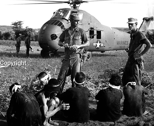 Operation Starlight, a U.S. Marine Corps search and destroy operation south of Chu Lai.  VC casualties stood at 599 killed and six captured.  Viet Cong prisoners await being carried by helicopter to rear area.  August 1965.  JUSPAO.  (USIA)<br /> EXACT DATE SHOT UNKNOWN<br /> NARA FILE #:  306-MVP-21-2<br /> WAR & CONFLICT BOOK #:  415