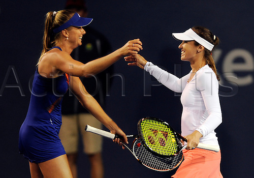 31.07.2013.la Costa Country Club, Carlsbad, California, USA.  Martina Hingis (SUI) returns to tennis and  reacts with doubles partner Daniela Hantuchiva (SVK) after they defeated the doubles team of Julia Goerges (GER) and Darija Jurak (CRO) during the Southern California Open played at the La Costa Resort & Spa in Carlsbad CA.