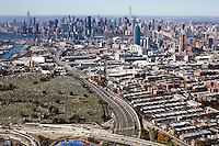 Aerial view of Brooklyn, Queens, and Manhattan, New York, New York, including First Calvary Cemetery in Long Island City.