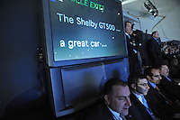 Men sit in front of the teleprompter during the Ford press presentation at the Detroit Auto Show in Detroit, Michigan on January 11, 2009.