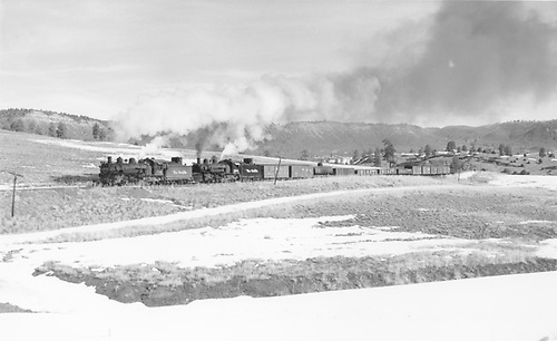 K-37 #494 (helper) and K-37 #498 (road engine) westbound with freight train near Willow Creek.<br /> D&amp;RGW  w. of Willow Creek, NM  Taken by Richardson, Robert W. - 2/23/1954
