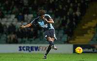 Sido Jombati of Wycombe Wanderers hits a shot at goal during the Sky Bet League 2 match between Yeovil Town and Wycombe Wanderers at Huish Park, Yeovil, England on 24 November 2015. Photo by Andy Rowland.