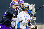Los Angeles, CA 02/15/14 - Garrett Remsen (Washington #15) and Anthony Noren (UCLA #11) in action during the Washington versus UCLA  game as part of the 2014 Pac-12 Shootout at UCLA.  UCLA defeated Washington 13-7.