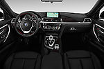 Stock photo of straight dashboard view of 2016 BMW 3 Series 328i 4 Door Sedan Dashboard