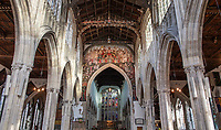 BNPS.co.uk (01202 558833)<br /> Pic: PhilYeomans/BNPS<br /> <br /> Doom finally has its day! - A 500 year old 'Day of Judgement' painting, that has survived Henry VIII th, the Puritans and even Victorian prudery has been restored to its former glory.<br /> <br /> Thought to be the largest medieval 'Doom' painting in the country, the striking image been painstakingly restored after a tumultuous 500 year history on the chancel arch of St Thomas Becket church in Salisbury.<br /> <br /> Originally painted in the 15th century, the chancel was white-washed during the Reformation before being uncovered nearly 300 years later in the early 19th century. <br /> <br /> Prudish Victorian's shocked by the naked images then recovered it before it finally re-emerged in 1881 as opinions relaxed. <br /> <br /> Experts have spent three months conserving the faded painting, which included injecting lime slurry behind areas of paint to affix them again to the wall. and delicately 'touching up' in places before finishing it with varnish to bring out its colour.<br /> <br /> Most pre 16th century churches and cathedrals in Britain would have been plastered with religious images and iconography to encourage their often illiterate congregation to good behaviour.<br /> <br /> But during Henry VIII th Protestant Reformation churches were stripped of all graven imagery and the paintings were either whitewashed over or completely destroyed.<br /> <br /> Because of this very few works still survive today making the Salisbury fresco a truly remarkable survivor.<br /> <br /> The restoration is part of a larger set of works at the historic church which are due to cost £1.5million.