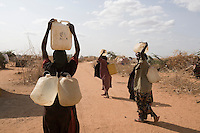 Kenya - Dadaab - Refugees collecting water from the well in Ifo camp.