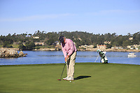 Dermot Desmond (IRL) putts on the 7th green during Sunday's Final Round of the 2018 AT&amp;T Pebble Beach Pro-Am, held on Pebble Beach Golf Course, Monterey,  California, USA. 11th February 2018.<br /> Picture: Eoin Clarke | Golffile<br /> <br /> <br /> All photos usage must carry mandatory copyright credit (&copy; Golffile | Eoin Clarke)