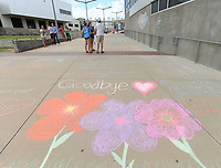 NWA Democrat-Gazette/ANDY SHUPE<br /> Students at Rogers Heritage High School decorate a wall and walkway between the school and arena Tuesday, June 13, 2017, after reports of teacher Linda Woods Allen was killed in Florida.