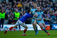 8th March 2020; Murrayfield Stadium, Edinburgh, Scotland; International Six Nations Rugby, Scotland versus France; Stuart Hogg of Scotland is tackled by Baptiste Serin of France