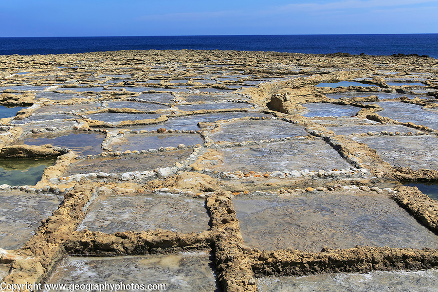 Historic ancient salt pans on coast near Marsalforn, island of Gozo, Malta