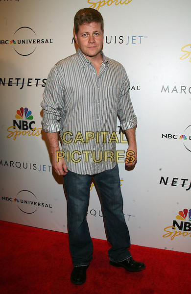 MICHAEL CUDLITZ .NBC Universal Pre-Superbowl Party held at Loew's Portifino Bay Hotel, Orlando, Florida, USA, .31st January, 2009..full length jeans grey gray striped shirt .CAP/ADM/RR.©Randi Radclif/Admedia/Capital Pictures