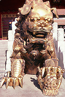 Pairs of lions, whose appearance owes more to myth than to zoological reality, stand guard outside each of the major halls in Beijing's Forbidden City. Males have balls under one of their front paws while females have (not so easily recognised) lion cubs.