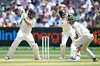 28th December 2019; Melbourne Cricket Ground, Melbourne, Victoria, Australia; International Test Cricket, Australia versus New Zealand, Test 2, Day 3; Tom Latham of New Zealand hits the ball - Editorial Use