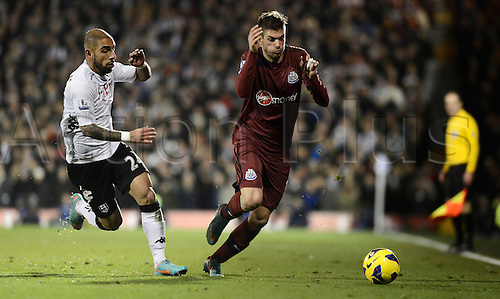 10.12.2012 London, England. Davide Santon of Newcastle takes on Ashkan Dejagah of Fulham during the Premier League game between Fulham and Newcastle United from Craven Cottage.