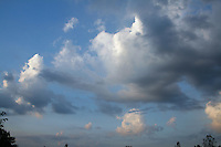 Cumulus Clouds With Grey Bases Against Blue Sky