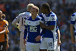 Home midfielder Craig Gardner (left) is consoled by teammate Cameron Jerome after being sent off in the first half at St. Andrew's stadium, during Birmingham City's Barclay's Premier League match with Wolverhampton Wanderers. Both clubs were battling against relegation from  England's top division. The match ended in a 1-1 draw, watched by a crowd of 26,027.