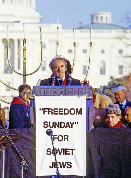 "02 July 2016 - Elie Wiesel, Auschwitz Survivor and Nobel Peace Prize Winner, Dies at 87. File Photo: Elie Wiesel, noted author, activist and winner of the Nobel Prize for Peace makes remarks at the ""Campaign to the Summit"", a march on Washington, D.C. supporting freedom for Jews living in the Soviet Union, on Sunday, December 6, 1987. 200,000 people marched to focus attention on the repression of Soviet Jewry, was scheduled a day before United States President Ronald Reagan and Soviet President Mikhail Gorbachev began a 2 day summit in Washington where they signed the Intermediate Range Nuclear Forces (INF) Treaty. Photo Credit: Ron Sachs/CNP/AdMedia"