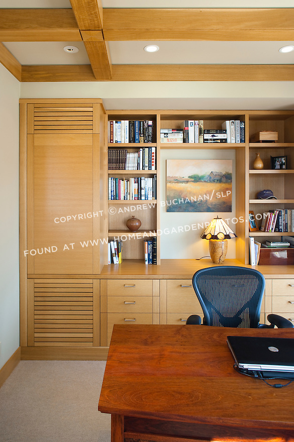 A wall of built-in shelves offers storage in this home office. this image is available through an alternate architectural stock image agency, Collinstock located here: http://www.collinstock.com