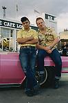 DJ Johnny B and DJ Chris leaning on their Sedan Deville 1966 pink Cadillac.<br /> <br /> &copy;&nbsp;Hazel Thompson