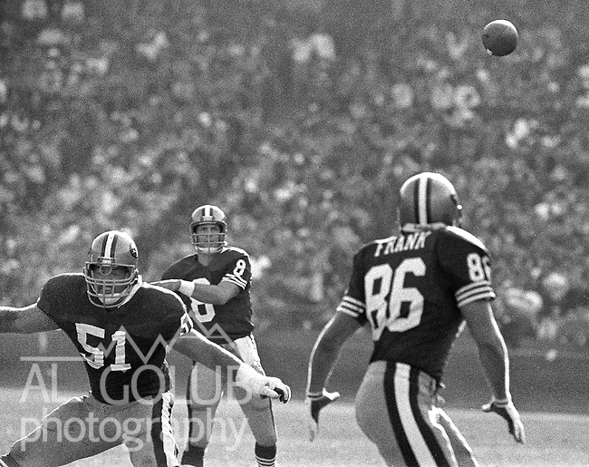 San Francisco 49ers vs Atlanta Falcons  at Candlestick Park Sunday, December 20, 1987..49ers beat Falcons 35-7.San Francisco 49ers Quarterback Steve Young (8) passes to San Francisco 49ers Tight End John Frank (86) with San Francisco 49ers Center Randy Cross (51) blocking..
