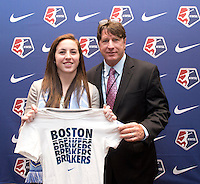 #32 overall pick Jami Kranich of the Boston Breakers stands with head coach Tom Durkin during the NWSL draft at the Pennsylvania Convention Center in Philadelphia, PA, on January 17, 2014.