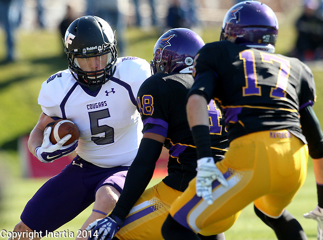 MANKATO, MN - NOVEMBER 1:  Brady Rose #5 for the University of Sioux Falls looks for running room past Marcus Gooden #48 and Justin Otto #17 from Minnesota State Mankato in the second quarter Saturday afternoon at Blakeslee Stadium in Mankato. (Photo by Dave Eggen/Inertia)