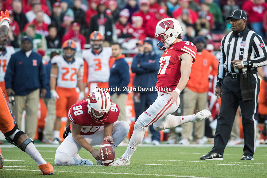 Wisconsin Badgers holder Luke Benzschawel (90) holds the ball for kicker Andrew Endicott (37) kicks a field goal during an NCAA Big Ten Conference football game against the Illinois Fighting Illini Saturday, November 12, 2016, in Madison, Wis. The Badgers won 48-3. (Photo by David Stluka)