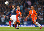 Shaun Maloney gets away from Nigel de Jong and Demy de Zeeuw