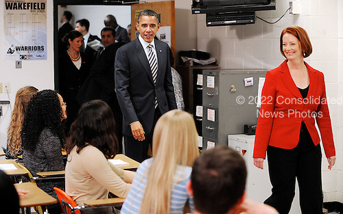 United States President Barack Obama and Australian Prime Minister Julia Gillard (R) enter a classroom to speak with advanced placement US history students at Wakefield High School in Arlington, Virginia, on March 7, 2011..Credit: Olivier Douliery / Pool via CNP