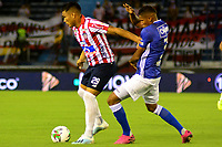 BARRANQUILLA-COLOMBIA, 19-10-2019: Teófilo Gutiérrez de Atlético Junior y Alex Rambal de Millonarios durante partido entre Atlético Junior y Millonarios, de la fecha 18 por la Liga Águila II 2019, jugado en el estadio Metropolitano Roberto Meléndez de la ciudad de Barranquilla. / Teofilo Gutierrez of Atletico Junior and Alex Rambal of Millonarios battle for the ball, during a match between Atletico Junior and Millonarios, of the 18th date for the Aguila Leguaje II 2019 played at the Metropolitano Roberto Melendez Stadium in Barranquilla city, Photo: VizzorImage / Alfonso Cervantes / Cont.