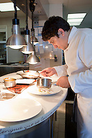 Chef Mauro Colagreco plates dishes in the kitchen of restaurant Mirazur, Menton, France, 18 September 2013