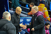 3rd December 2017, Etihad Stadium, Manchester, England; EPL Premier League football, Manchester City versus West Ham United; Pep Guardiola manager of Manchester City  and David Moyes manager of West Ham  shake hands