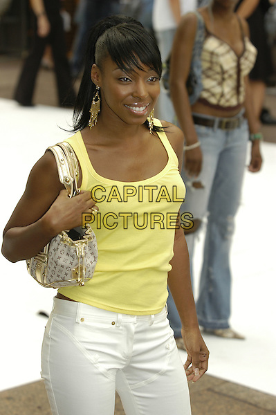 "SABRINA - MIS-TEEQ.""I, Robot"" film premiere arrivals .Odeon Cinema, Leicester Square.London 4th August 2004.CAP/PL.half length, yellow tank top, bag, purse, dangling gold earrings.www.capitalpictures.com.sales@capitalpictures.com.©Capital Pictures"