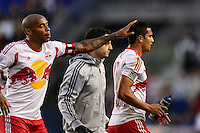 Thierry Henry (14) of the New York Red Bulls pats Tim Cahill (17) on the head. The New York Red Bulls defeated FC Dallas 1-0 during a Major League Soccer (MLS) match at Red Bull Arena in Harrison, NJ, on September 22, 2013.