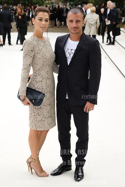 Giorgia Surina and Italian actor, Nicolas Vaporidis arriving for the Burberry Prorsum catwalk show as part of London Fashion Week SS13, Kensington Gardens, London. 17/09/2012 Picture by: Steve Vas / Featureflash