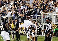 Florida International University football player wide receiver T.Y. Hilton (4) celebrates against the Duke University on October 01, 2011 at Miami, Florida. Duke won the game 31-27. .