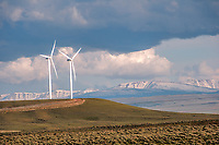 A glimpse at a windfarm in Wyoming, USA. A few of many thousands of power generating windmills that now cover the landscape.