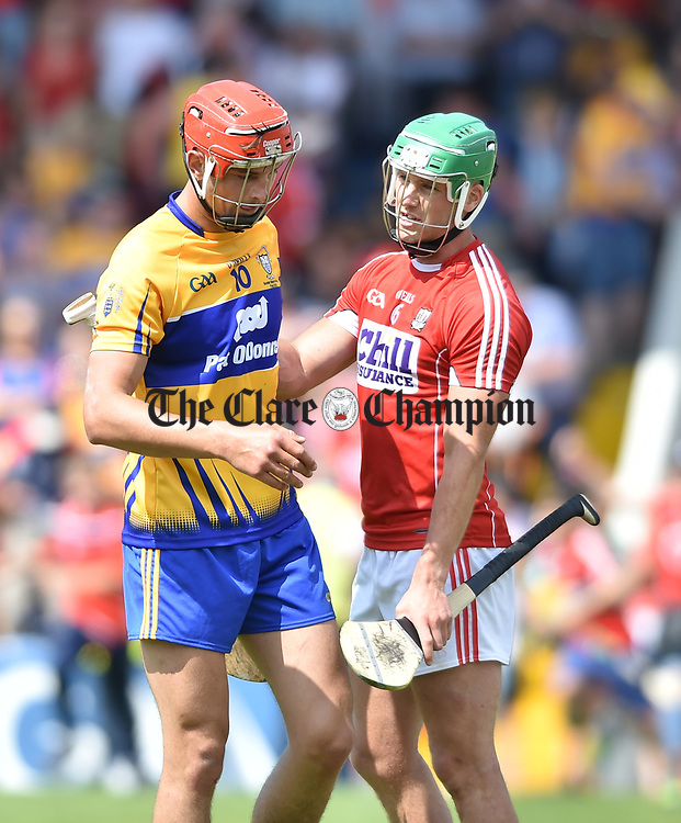 Peter Duggan of Clare is consoled by Eoin Cadogan of Cork fllowing their Munster senior hurling final at Thurles. Photograph by John Kelly.